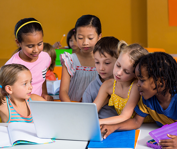 Children Using Laptop In The Classroom